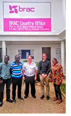 John Mullett outside BRAC offices in Tanzania
